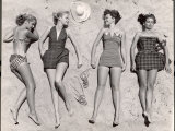 Models Sunbathing  Wearing Latest Beach Fashions