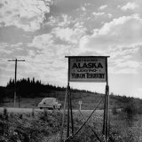 Road Sign Showing the Dividing Line Between Alaska and the Yukon Territory
