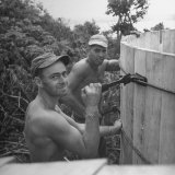 US Navy Seabees Building Wooden Water Tanks