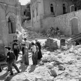 Arabs and Jews Walking in Opposite Directions after End of Truce