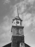 Church Steeple  with Clock Sitting in Top Section of Tower