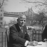 Broker Charles E Merrill Seated Outside at Table