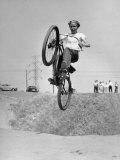 Motorcycle Rider Jerry Ridgman Soaring over Embankment
