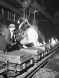 Worker Pouring Hot Steel into Molds at Auto Manufacturing Plant