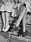 Women Showing Off Current Shoe and Textured Hosiery Fashions