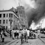 Scenes of Ruin  People Fleeing  Buildings Burning  as a Result of an Earthquake Disaster
