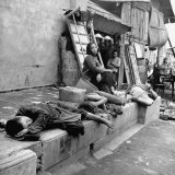 During the Famine  Hunger Children and Adults Sleeping