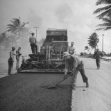 US Navy Seabees Spreading Asphalt During Creation of Air Base
