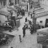 Jewish Families Waiting Outside their Homes to Be Evacuated by Arab Troops