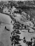 Nationalist Chinese Soldiers Marching Through City Street While Retreating from Communist Forces