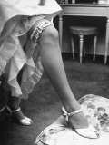 Bride Barbara Alvin Wearing a Blue Garter on Her Leg for Her Wedding