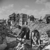 People Salvaging Bricks and Boards from Bomb-Damaged Bldgs of a Devastated City in the Ruhr Valley