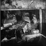 Machine Digging into Wall of Coal Mine