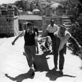 Wounded Arab Legionnaire Is Carried by Civilian Volunteers