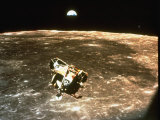 Apollo 11&#39;s Lunar Module Flying over the Moon with Earth in the Bkgrd