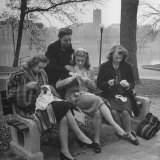 Members of Ballet Russe Sitting in a Park Mending their Shoes and their Tights