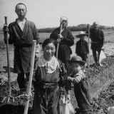 Postwar Japanese Farming Family Posing with their Tools in the Field