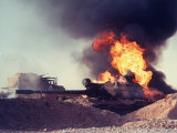 Iraqi Tank Burning While US Army Convoy Drives Past into Iraq During Gulf War