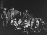 Explorer Boy Scouts  Post 28  Gathered around Campfire at Night with Troop Leaders