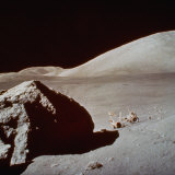 Apollo 17's Rover  a Lunar Vehicle  on the Surface of the Moon Next to Giant Rock