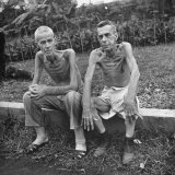 Lee Rogers and John C Todd  Sitting Outside Japanese Prison Camp After Release by Allied Forces