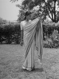 Woman Demonstrating How to Put on an Indian Sari