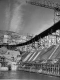 "The Grand Coulee Dam under Construction with a Sign in the Bkgrd That Says: ""Safety Pays"""