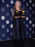 Country Singer Trisha Yearwood Holding Her Awards at the 40th Annual Grammy Awards