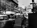 Man Walking Through Time Square