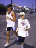 Singer Madonna Jogging with Trainer