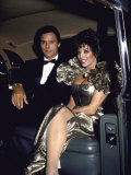 Actors Michael Nader and Joan Collins Sitting in a Car