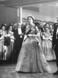 Queen Elizabeth and Philip Walking Through Ball Room