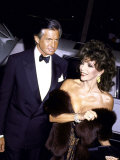 Actors George Hamilton and Joan Collins
