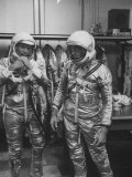Astronauts John Glenn and Alan Shepard Putting on their Space Suits