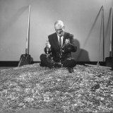 Man Sitting in a Pile of Dimes for Olympic Games