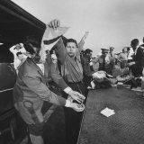 Cubans Being Searched by Customs Officials before Returning to Cuba