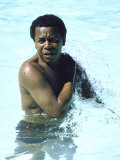 Comedian Flip Wilson Cooling Off in a Motel Pool During Cross-Country Car Trip