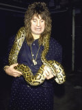 Rock Musician Ozzy Osbourne with a Snake around His Neck