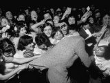 Singer Johnnie Ray  Bringing His Young Followers to the Brink of Frenzy