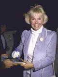 Singer Actress Doris Day Signing a Photograph