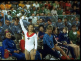Soviet Gymnast Olga Korbut Holding Up Flowers at the Summer Olympics