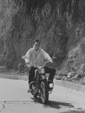 Country Singer Roger Miller Riding a Motorcycle