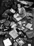 Life Photographer Margret Bourke-White Sitting Amidst Contents of Opened Suitcase