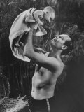 "Actor Charlton Heston Lifting Son Fraser  Portraying the Baby Moses  in ""The Ten Commandments"""