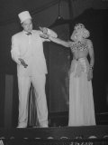 Orson Welles Performing a Magic Show on Stage