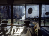 Architect Eliot Noyes Burning Leaves in Yard of Home He Designed Himself