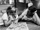 Apollo 8 Astronaut William Anders Reading Newspaper Comics with Some of His Children at Home