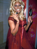 Singer Drag Queen Rupaul Wearing Red Teddy While Checking Lipstick at Event