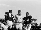Football Coach Paul Bear Bryant of Texas A&M Talking W Players During a Game