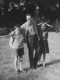 French Author Albert Camus Poised Standing on Lawn  Arms around His Twins Jean and Catherine